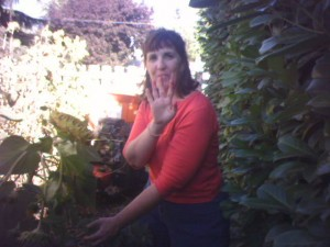 Annie Haynes, ASL Interpreter and artist, in her garden with berry-stained fingers