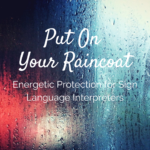 "rainy, foggy window with red and white lights shining through streaks of rain on window with white text ""put on your raincoat. energetic protection for sign language interpreters"" Tag: november workshops self-care ceus"