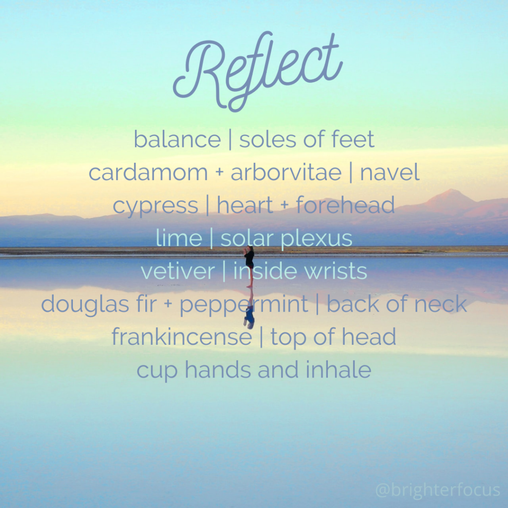 "person standing on the beach with the water reflecting the mountains in the distance and the blue and yellow sky ""Reflect, balance 