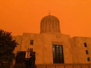 oregon state capital building with a smoky, hazy, orange sky behind the building Tag: dear 2020